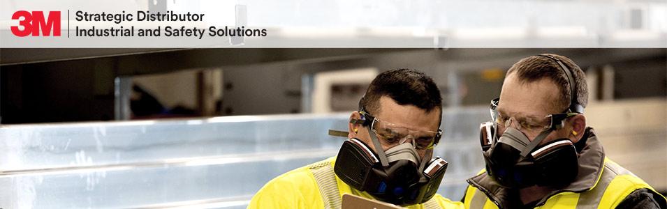 Photo of two men at work, wearing 3Mrespirators.