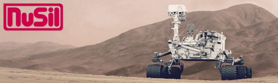 Nusil Silicones logo with photo of NASA Mars Rover