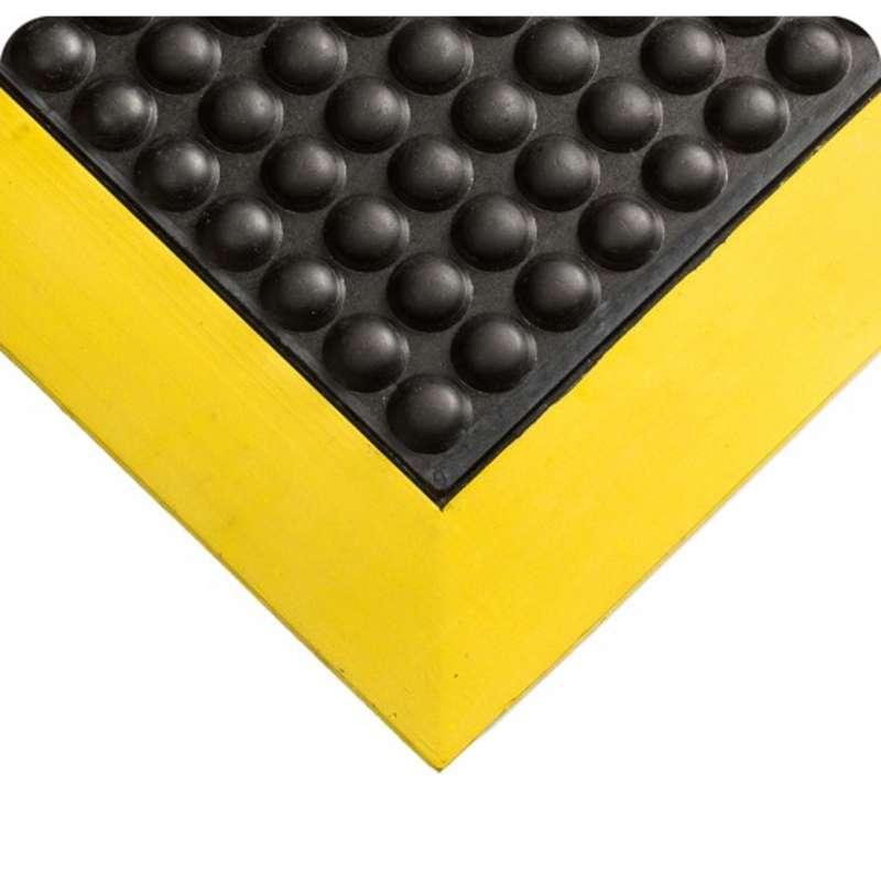"Tuf Sponge 27 x 60"" Ergonomically Ribbed Surface Black Vinyl Sponge Matting with Yellow Borders, 3/8"" Thick"
